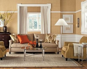 modern-brown-and-white-beige-living-room-with-brown-sofa-orange-pillow-table-carpet-gordyn-big-window-and-wall-decor